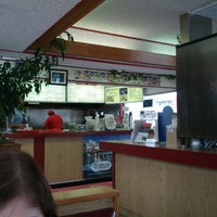 Photo taken at Olympus Burgers by Spencer S. on 4/5/2013