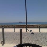 Photo taken at Praia dos Amigos by Raimundis M. on 5/10/2013