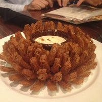 Photo taken at Outback Steakhouse by Amna E. on 4/11/2013
