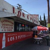 Photo taken at Los Cinco Puntos by Apryl J. on 4/3/2015