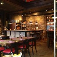Photo taken at BEVO Bar + Pizzeria by Chris L. on 3/13/2013