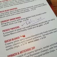 Photo taken at Applebee's Neighborhood Grill & Bar by Stephanie C. on 3/1/2013
