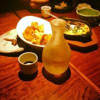 Photo taken at 魚もつ鍋 魚呑 うおどん 高円寺店 by Yuhya W. on 3/20/2013