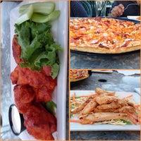 Photo taken at Boston Pizza by Asma A. on 7/6/2014