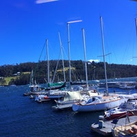Photo taken at Oyster Cove Marina by Spatial Media on 1/1/2014