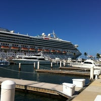 Photo taken at Mallory Square by Joshua A. on 12/7/2012