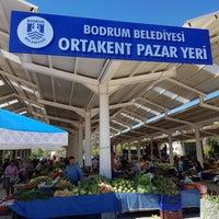 Photo taken at Ortakent Semt Pazari by Gökhan D. on 8/7/2018