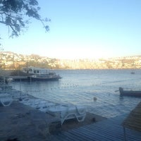 Photo taken at moon beach clup by tandoğan m. on 6/23/2014