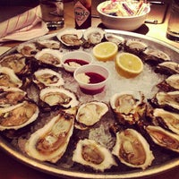 Photo taken at Coast Seafood & Raw Bar by Kyle L. on 3/21/2013