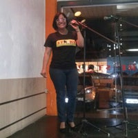 Photo taken at Strike Boliche & Karaoke by Regianne K. on 12/2/2013