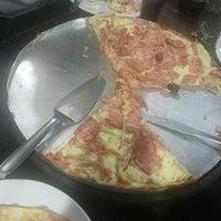 Photo taken at Casa da Pizza by Nayara V. on 3/4/2013