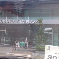 Photo taken at Olympia Thai Tower by Warit  Pechthong L. on 2/17/2015