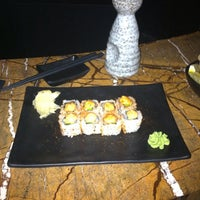 Photo taken at Mizu Asian Bistro + Bar by Sue T. on 1/3/2014