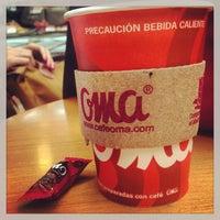 Photo taken at Café Oma Muelle Internacional by Frank M. on 8/9/2013