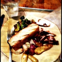Photo taken at Urban Plates by christie s. on 11/19/2012