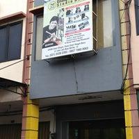 Photo taken at Gilang Ramadhan Studio Band by Mark E. on 6/8/2013