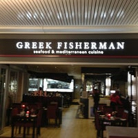 Photo taken at Greek fisherman by Cem B. on 3/16/2013