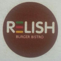 Photo taken at Relish Burger Bistro by Ashley S. on 7/25/2013