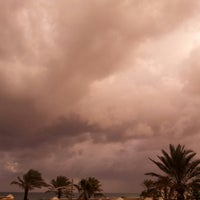 Photo taken at Palm City Rocky Beach by Zaki B. on 12/8/2014