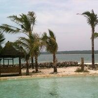 Photo taken at Umang Island Resort by Ratih H. on 6/13/2015