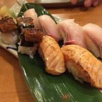 Photo taken at Naruto Uo Ichiba Izakaya 鳴門魚市場居酒屋 by Cherry M. on 8/9/2014