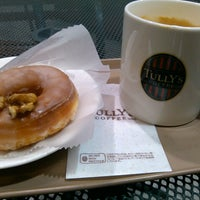 Photo taken at Tully's Coffee by Yoshinori S. on 3/22/2013