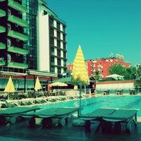 Photo taken at Club Bayar Beach Hotel by Ezgi Gizem E. on 8/13/2013
