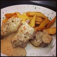 Photo taken at Tarpon Restaurant Night Bar by Marvino B. on 4/4/2013