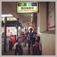 Photo taken at Nishi-nippori Station by Mari I. on 6/8/2013