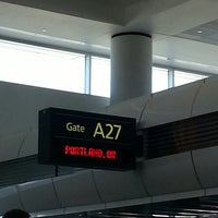 Photo taken at Gate A27 by Louis G. on 10/26/2013