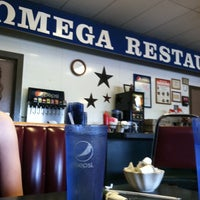 Photo taken at Omega Restaurant by Leah M. on 6/16/2014