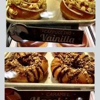 Photo taken at Krispy Kreme by Paola N. on 5/9/2013