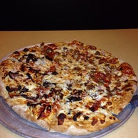 Photo taken at The Loop Pizza Grill by Kim C. on 8/22/2014