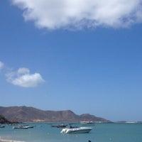Photo taken at Playa La Galera by Amelí R. on 3/28/2013