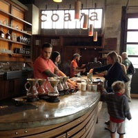 Photo taken at Coava Coffee Brew Bar by Chau V. on 5/8/2013