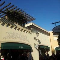 Photo taken at La Reggia Designer Outlet by Leonardo L. on 1/12/2013