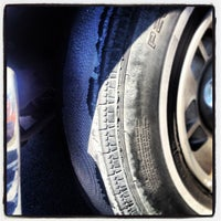 Photo taken at Discount Tire® Store by Richard F. on 7/30/2013