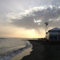Photo taken at Pontile di Ostia by Paola B. on 5/18/2013