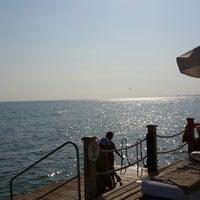 Photo taken at Voyage Beach by Eliff on 7/12/2013