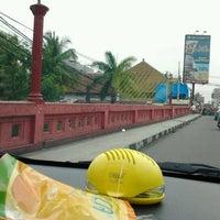 Photo taken at Jembatan Merah by Raymond T. on 10/12/2012