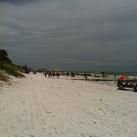 Photo taken at Coquina Beach by Robin P. on 7/4/2013