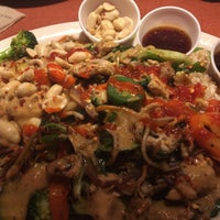 Photo taken at Mongolian Grill by Christian D. on 12/5/2015
