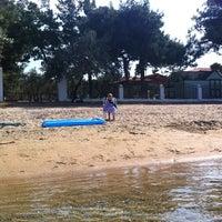 Photo taken at Koviou Beach by Ольга Н. on 8/19/2013