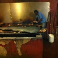 Photo taken at Scotchies Jerk Centre by Jorge T. on 4/9/2013