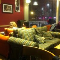 Photo taken at Green Caffè Nero by Maciej T. on 3/8/2013