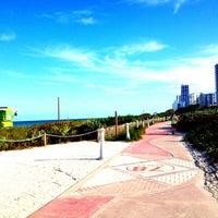 Photo taken at North Shore Beachwalk by Giancarlo Z. on 4/18/2013
