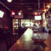 Photo taken at Mad Donkey Beer Bar & Grill by Brian R. on 4/1/2013