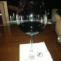 Photo taken at Fleming's Prime Steakhouse & Wine Bar by Meghan R. on 7/30/2013