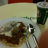 Photo taken at Signatures Food Court by bibi h. on 1/23/2013