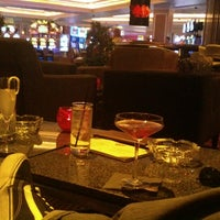 Photo taken at HIT Bar & Lounge by Víctor J. on 1/31/2014